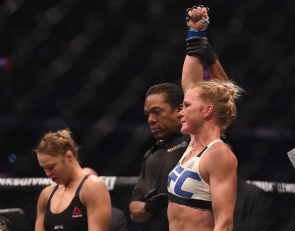 Nov 15, 2015; Melbourne, Australia; Holly Holm (blue gloves) celebrates after defeating Ronda Rousey (not pictured) during UFC 193 at Etihad Stadium. Mandatory Credit: Matt Roberts-USA TODAY Sports usp ORG XMIT: USATSI-256554 [Via MerlinFTP Drop]
